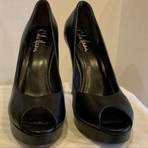Black Cole Haan peep toe platform heels
